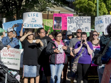 Protesters outside of North Battleford Provincial Court House listen to singers in the middle of a blocked off 100th Street where Gerald Stanley made a court appearance on August 18, 2016.