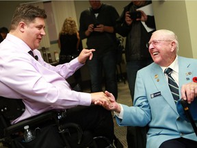 Minister of Veterans Affairs and Associate Minister of National Defence Kent Hehr speaks with veteran David W. Robinson after announcing the plan to re-open the Veteran Affairs office by November 2016 in Saskatoon on August 10, 2016
