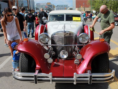 Kim Postnikoff shines up his Excalibur Phaeton IV at the Show and Shine in Saskatoon on August 21, 2016.