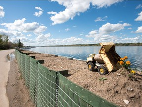 A retaining wall holds water back from running on to the roads in Manitou Beach, SK on Friday, August 5, 2016.
