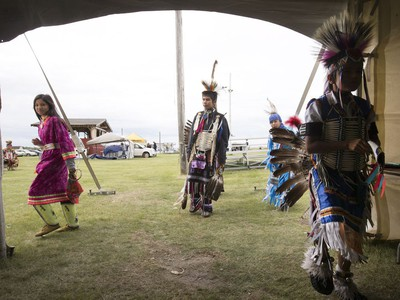 Yooung dancers get ready for the Grand Entry on day two of Wanuskewin Days Cultural Celebration and Powwow at Wanuskewin Heritage Park, August 24, 2016.