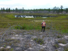 View of a pond with a distinct circular structure identified as a magnetic anomaly by De Beers Canada in its survey of CanAlaska Uranium's West Athabasca diamond project. Credit: CanAlaska Uranium Ltd.