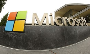 This July 3, 2014, file photo, shows the Microsoft Corp. logo outside the Microsoft Visitor Center in Redmond, Wash.