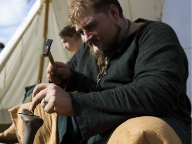 Jamin Schumacher makes a Brass Serpent Ring during the Prairie Paladin Medieval Market and Faire located at the University of Saskatchewan in Saskatoon, October 1, 2016.