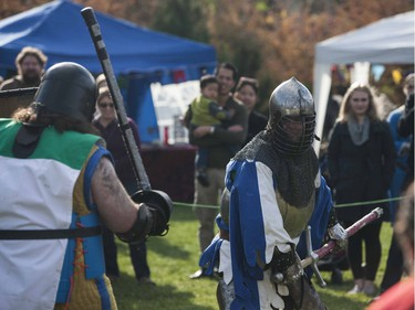Members of Myrgan Wood perform battle scenes in front of a crowd during the Prairie Paladin Medieval Market and Faire located at the University of Saskatchewan in Saskatoon, October 1, 2016.