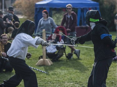 Two swordsmen recreate traditional battle scenes in front of a crowd during the Prairie Paladin Medieval Market and Faire located at the University of Saskatchewan in Saskatoon, October 1, 2016.