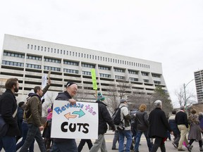 A crowd marches downtown in light of the recent cuts to the Lighthouse facility in Saskatoon, Saskatchewan on Saturday, October 22nd, 2016.