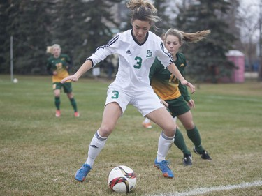 U of S Huskies #3 Ella Molnar defends the ball against a Regina Cougars player during the game at the University of Saskatchewan in Saskatoon, October 29, 2016.