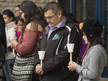 People attend a candlelight vigil outside the Gordon Oakes Red Bear Student Centre on the University of Saskatchewan campus to support those affected by the tragedies of youth suicides in northern Saskatchewan, October 20, 2016.