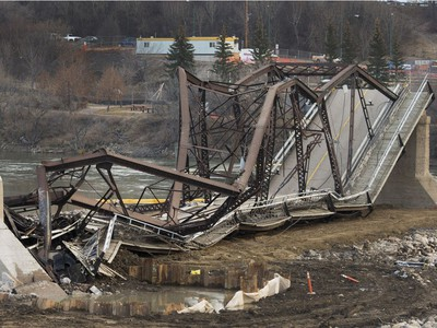 The remaining traffic bridge pillar on the west side of the city is being chipped away and finally dropping the remaining span left of the structure to the ground, November 17, 2016.