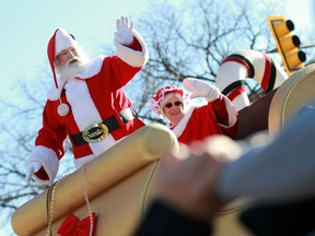 Santa and Mrs. Claus wave to the crowd, closing off the annual Santa Claus Parade downtown Saskatoon on November 20, 2016.