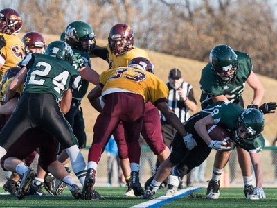 Holy Cross Crusaders tailback Dhugal Baxter-Jones pushing in a touchdown against the LeBoldus Golden Suns during the high school football 4A provincial final at SMS field in Saskatoon, November 12, 2016.