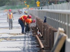 Work continues on the deck of the University Bridge on May 25, 2015 in Saskatoon.