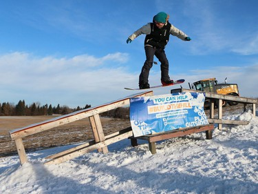Snowboarders take to the hill during a ride along and meet and greet with Olympic medalist Mark McMorris and his brother Craig McMorris, member of the Canadian national snowboarding team in slopestyle at Diefenbaker Park in Saskatoon on December 21, 2016.