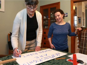 Co-founders of Saskatoon's solidarity march for the Women's March on Washington Karen Brander and Alice de Cloedt prepare a sign for Saturday's march in Saskatoon on January 18, 2017. (Michelle Berg / Saskatoon StarPhoenix)