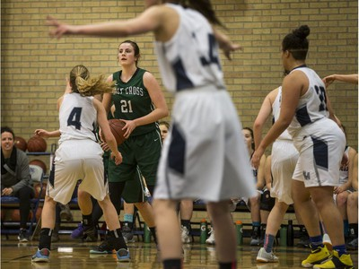 Holy Cross Crusaders' Kyla Shand looks to pass the ball against the Walter Murray Marauders  in high school girl's basketball action at Walter Murray Collegiate in Saskatoon, January 17, 2017.
