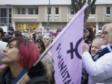 As a crowd gathers at City Hall in downtown Saskatoon, attendants clap during a speech before the march to raise awareness of women's rights, January 21, 2017.