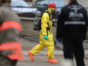 The hazardous materials unit recovers a suspicious package that was declared non-hazardous from an office building at 211 Fourth Avenue South in Saskatoon on March 27, 2017. (Michelle Berg / Saskatoon StarPhoenix)