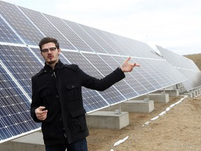 SASKATOON, SK - April 25, 2017 - Sask Polytechnic mechanical engineering student Cody Leusca explains how the solar panel's angle changes to optimize sun exposure at one of the first solar power generation co-operatives in the province at the Landfill Gas Power Generation Facility in Saskatoon on April 25, 2017. (Michelle Berg / Saskatoon StarPhoenix)