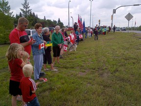 Supporters line the side of the road to support the Wounded Warriors Weekend cavalcade.
