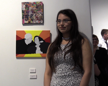 Tonia Bird stands near one of her pieces in Urban Canvas' final show of the year.