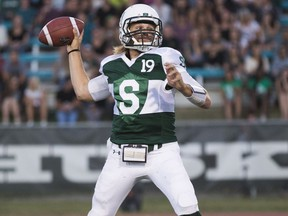 Huskies' quarterback Kyle Siemens throws the football during the team's home opener.