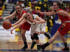 Saskatchewan Huskies' Libby Epoch can't hold on to the ball as she's swarmed by Laval Rouge et Or players during first half quarter-final action U Sports Women's Basketball action at the CARSA Performance Gym in Victoria, B.C., on Thursday, March 9, 2017.
