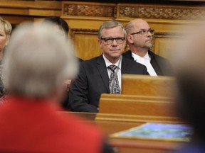 Saskatchewan Premier Brad Wall takes his seat the legislature for his last throne from the speech at the Saskatchewan Legislative Building in Regina, Wednesday, October 25, 2017