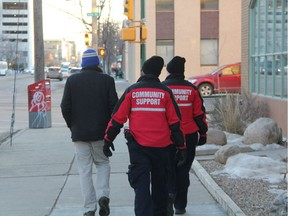 Community Support Officers (CSO) walk a man to the downtown bus loop in order to get him home safe after he was asked to leave a business in downtown Saskatoon on Nov. 30, 2017. While officers initially offered him a ride from a stabilization unit, he said he'd rather take the bus, and officers responded by working with transit officials to get him on the right bus.