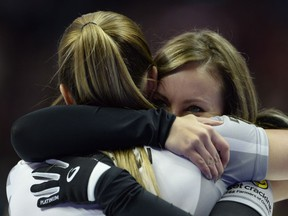 Rachel Homan, right, and Lisa Weagle hug each other after winning the 2017 Roar of the Rings Canadian Olympic Trials in Ottawa on Sunday, Dec. 10, 2017. Homan and her Ottawa-based curling team will represent Canada at the Winter Olympics.