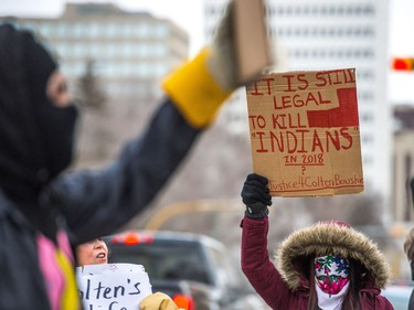 Protesters wave signs at vehicles driving along Victoria Avenue outside of Regina's Queen's Bench Court on Feb. 10, 2018, the day after Gerald Stanley was acquitted of all charges relating to the shooting death of Colten Boushie.