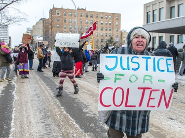 Protesters wave signs on Victoria Avenue outside of Regina's Queen's Bench Court on Feb. 10, 2018, the day after Gerald Stanley was acquitted of all charges relating to the shooting death of Colten Boushie.