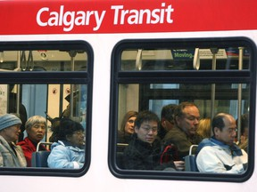 Commuters cram onto a crowded C-Train car in the early hours of rush hour in Calgary on October 28, 2009.