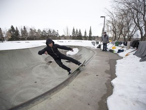 Ben Riabko, left, skateboards in the bowl at the Lions Skatepark in Saskatoon, SK on Saturday, March 24, 2017. Ben Riabko along with Josh Paul, right, and some other friends have been clearing snow out of the bowl to get some skateboarding in during the warmer weather.