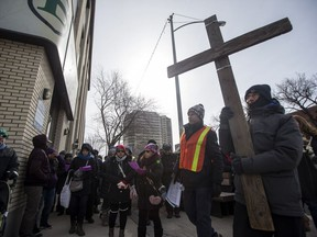 People take part in the Way of the Cross community prayer walk in downtown Saskatoon, SK on Friday, March 30, 2017.