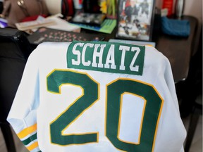 The family of Logan Schatz sets up a makeshift memorial of their son's photos and jersey at their home in Allan, Saskatchewan on Monday April 9, 2018. Leah Hennel/Postmedia