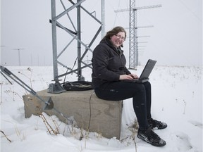 """Lindsay Goodwin at the U of S """"SuperDARN"""" radar site, one of 40 radars worldwide collecting data on the impact of solar activity."""