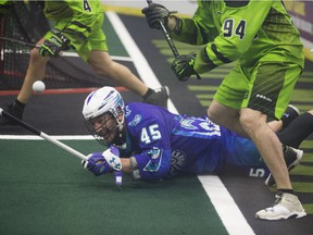 Rochester Knighthawks defender Luc Magnan falls to the ground during Game 1 of the National Lacrosse League's Champions Cup final at SaskTel Centre in Saskatoon on Saturday, May 26, 2018.
