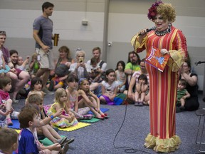 China White reads a story book to a crowd during the Pride event, Drag Queen Story Time, at Frances Morrison Library  in Saskatoon on Saturday, June 9, 2018.