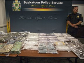Inspector Dale Solie stands next to the various drugs on display during a media event showcasing a significant seizure of illegal drugs at the Saskatoon Police Headquarters in Saskatoon, SK on Thursday, June 7, 2018.
