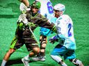 Saskatchewan Rush defender Nik Bilic keeps tabs on Rochester Knighthawks forward Josh Currier during Game 2 of their National Lacrosse League final Saturday in Rochester, N.Y. (Micheline Veluvolu/Rochester Knighthawks)