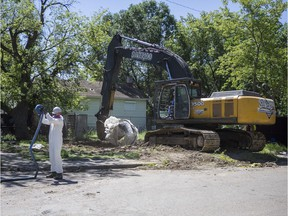 SASKATOON,SK--JULY 16 9999-NEWS-ASBESTOS HOUSE- Demolition of a house on Avenue B that caused concerns in the neighbourhood due to signs warning about the presence of asbestos was finally completed on Monday in Saskatoon, SK on Monday, July 16, 2018.