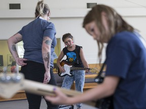 Soleil Oulovsky practises guitar at the loud band practice during a workshop at the second week of Girls Rock Camp, a week-long summer program that teaches young girls collaborative music creation and performance at Mayfair United Church in Saskatoon, SK on Monday, July 23, 2018.