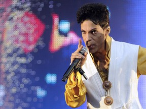 "This June 30, 2011 file photo shows US singer and musician Prince performing on stage at the Stade de France in Saint-Denis, outside Paris. - The estate of prolific late pop icon Prince made more than 300 songs from his later career available on digital download and streaming services for the first time on Friday, August 17, 2018. The tracks come from 23 albums -- from 1995's ""The Gold Experience"" to 2010's ""20Ten"" -- that have been launched online as part of a deal struck with Sony's Legacy Recordings. There is also a new 37-track compilation called ""Prince Anthology 1995-2010,"" made up of highlights from the 23 albums."