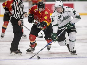 University of Saskatchewan Huskies forward Wyatt Johnson battles for the puck with University of Calgary Dinos forward Graham Black during first period U Sport Hockey action at Merlis Belsher Place in Saskatoon, SK on Tuesday, October 12, 2018.