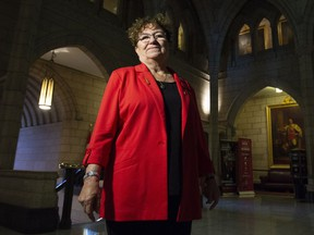 """Senator Yvonne Boyer poses for a photo in the foyer of the Senate on Parliament Hill in Ottawa, Tuesday October 23, 2018. Tubal ligations carried out on unwilling Indigenous women is one of the """"most heinous"""" practices in health care happening across Canada, says Boyer, a Metis lawyer and former nurse who is now a senator for Ontario.THE CANADIAN PRESS/Adrian Wyld"""