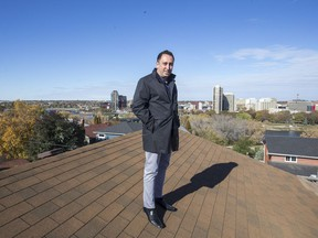 Meridian Development Corp.'s Karl Miller stands atop the church he plans to replace with a seven-storey condo tower — the project that convinced him to quit doing buildings that require rezoning.