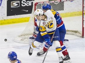 Saskatoon Blades forward Chase Wouters tries to deflect the puck under pressure from the Edmonton Oil Kings defence in Saskatoon on Saturday, February 2, 2019.