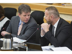Saskatoon chief financial officer Kerry Tarasoff, right, speaks to city manager Jeff Jorgenson at city hall in late 2018.