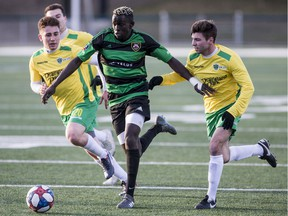 Calgary Foothills forward Moses Danto runs the ball under pressure from the Saskatchewan Selects defence in the Saskatchewan Summer Soccer Series in Saskatoon on Friday, May 4 2019.